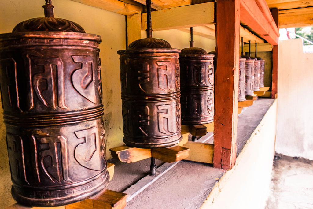 The prayer wheels at the Hemis Monastery which are to be spun only clockwise. Prayer wheels like these are planted all over Leh.