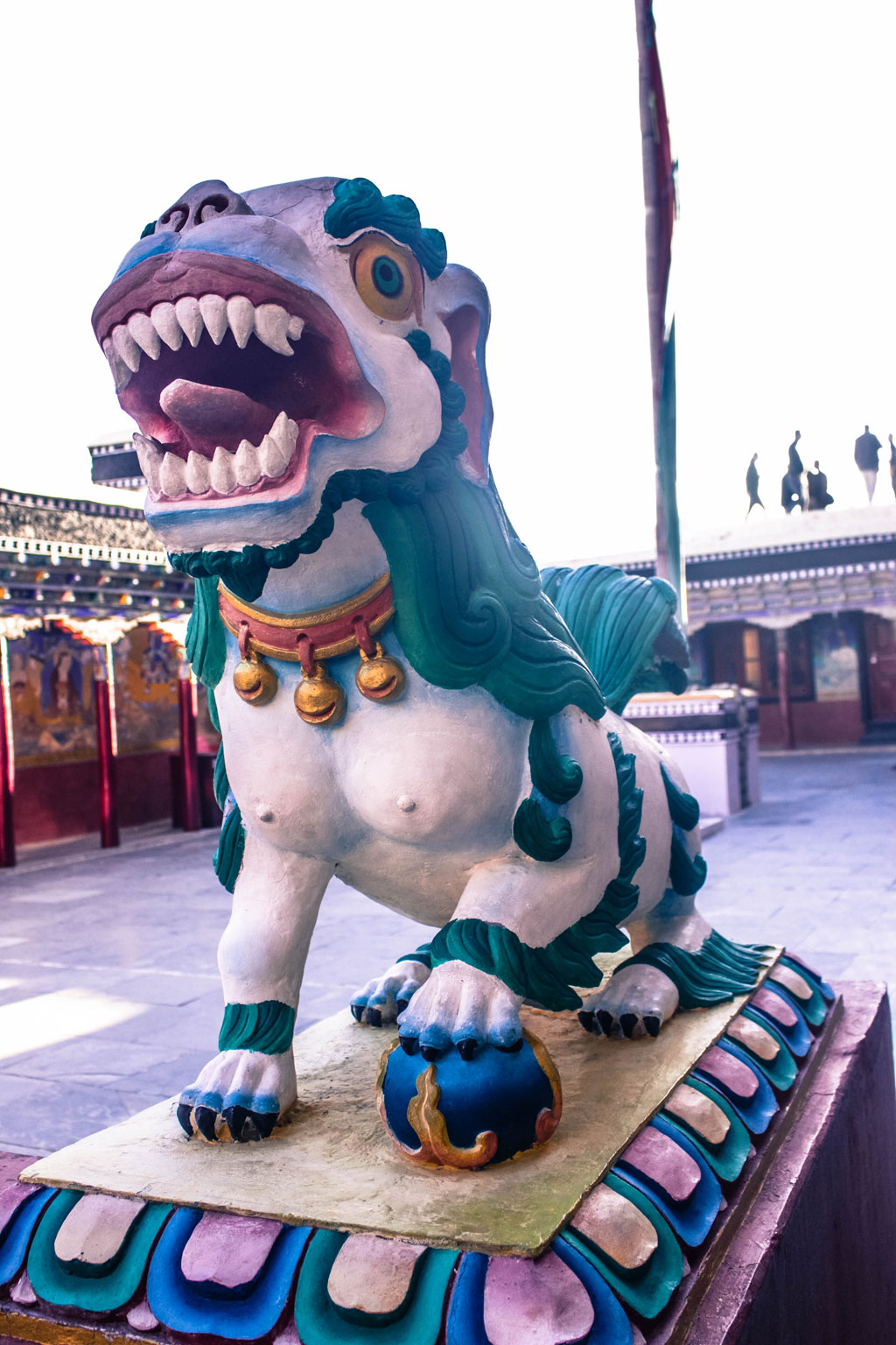 A snow lion statue guards the entrance of the Thiksay Monastery