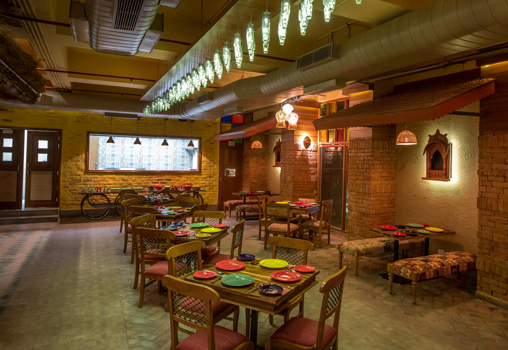 The rustic and earthy interiors are inspired by the dhabas of India