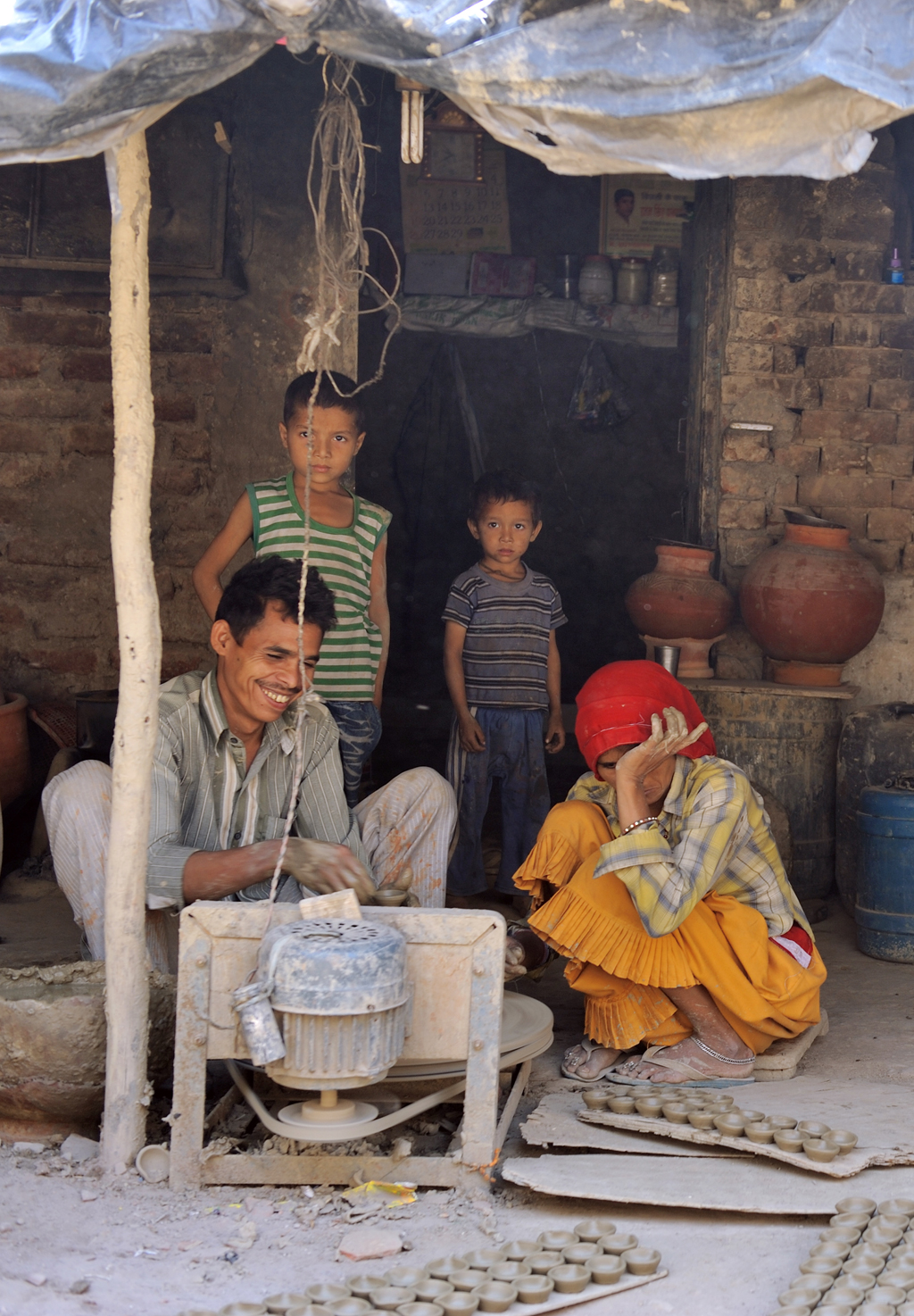 A potter's family with earthen diyaas