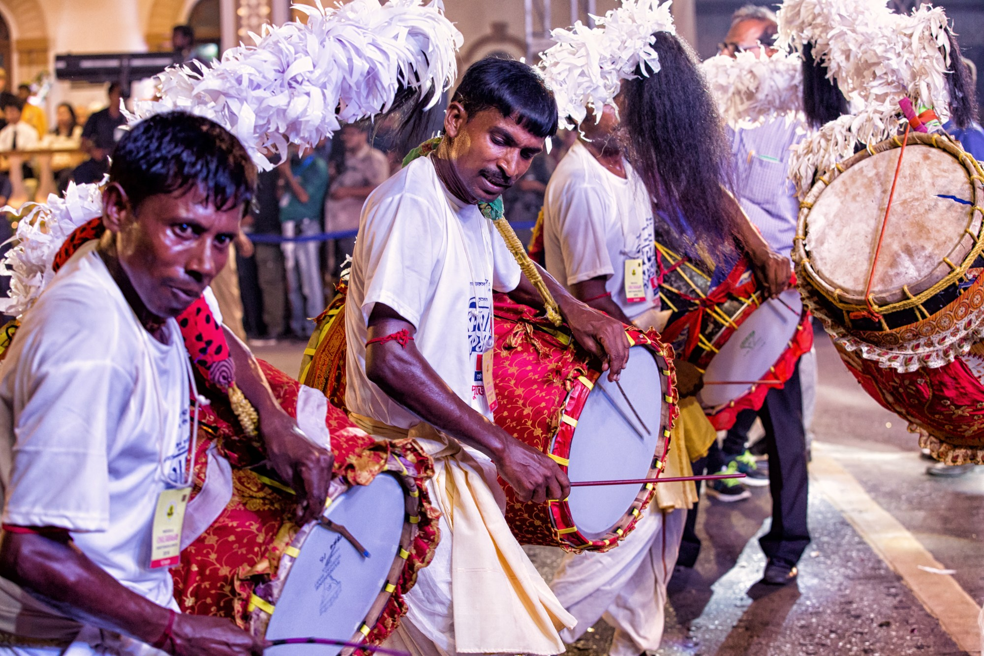 Drummers beat to the sounds of music during a procession