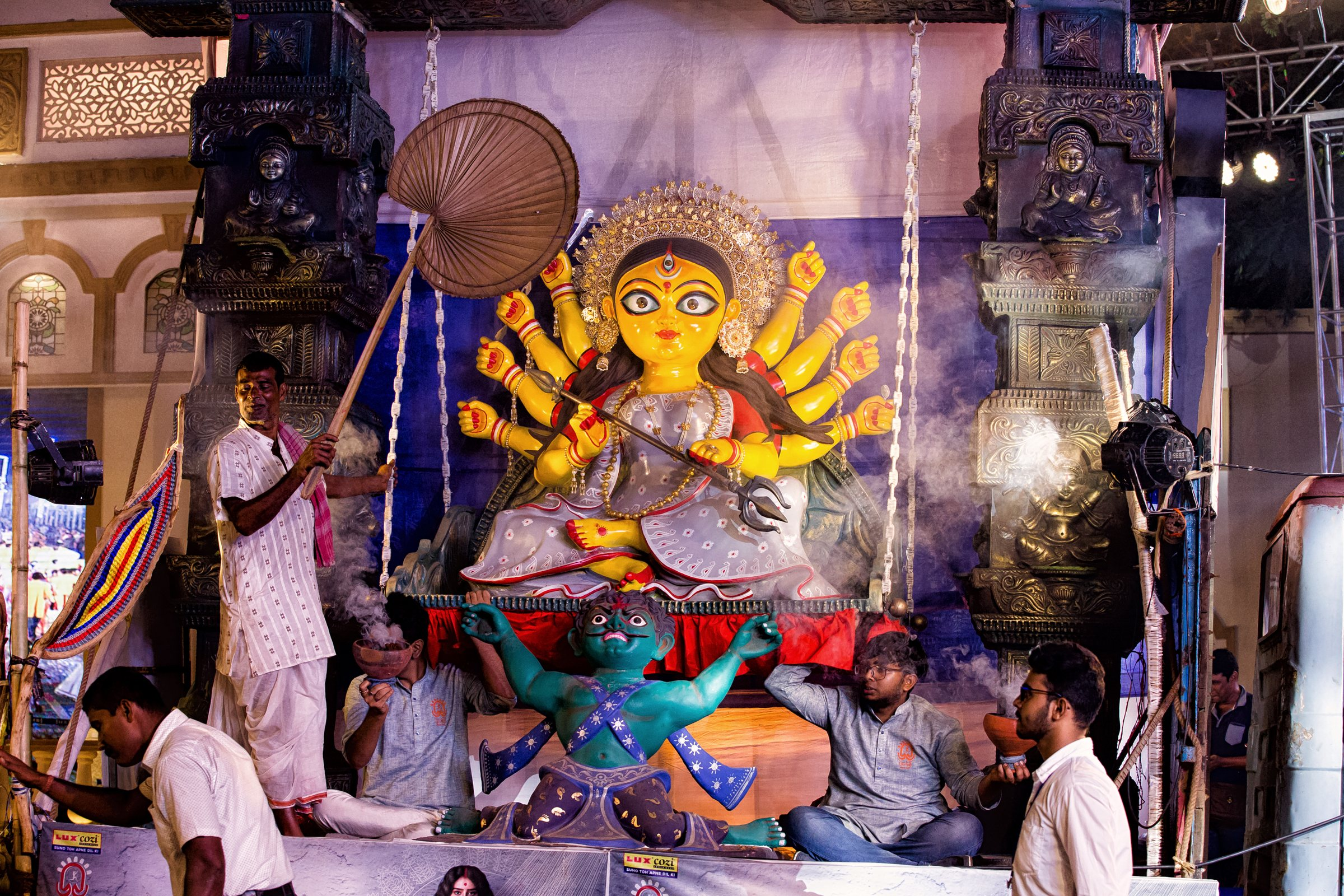 Large-scale idols of Maa Durga are set up across the city for people to worship